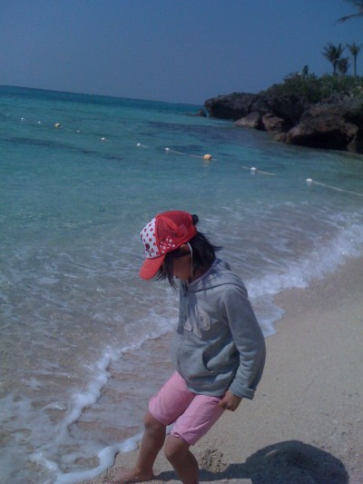 A girl playing on a beach